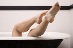 Legs off side tub Stock Photography
