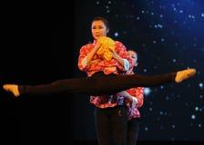 Legs open-Folk dance Stock Photo