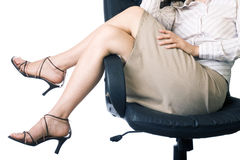 Legs over the chair Stock Images