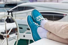 Legs in pants and bright blue topsiders on yacht Royalty Free Stock Photos