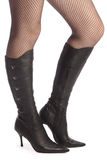 Legs in panty-hose and top-boots royalty free stock images