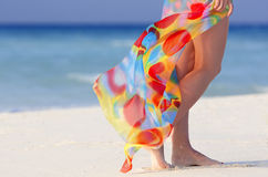 Legs with pareo. Walking on the beach young girl Royalty Free Stock Photography