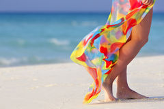 Legs with pareo. Walking on the beach young girl Royalty Free Stock Photos