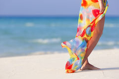 Legs with pareo. Walking on the beach young girl Royalty Free Stock Photo