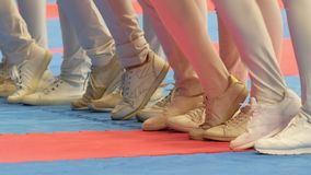 Legs of participants on warm-up at thekarate tournament. Close up stock video