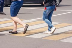 Legs of pedestrians in a crosswalk Stock Photography
