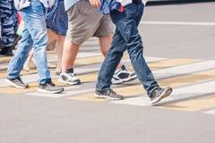Legs of pedestrians in a crosswalk stock photography