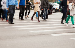Legs of pedestrians on a pedestrian crossing Stock Image