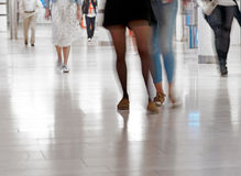 Legs of people in blurred motion Stock Photography