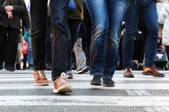 Legs of people crossing a street Royalty Free Stock Photo