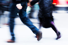 Legs of people in motion blur walking in the city Stock Photos