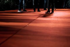 Legs of people on red carpet royalty free stock image