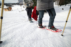 Legs of People while snowshoeing in the mountains Stock Photography