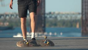 Legs performing a skate trick. Person with skateboard outdoor. Need to improve my skills. Talent and stubbornness stock footage