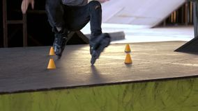 Legs of person rollerblading. Inline skater and slalom cones. Be fast and agile stock footage