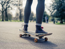 Legs of person skateboarding in the park Stock Photography