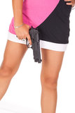 Legs and pistol. Brunette legs and pistol isolated in white background stock photography