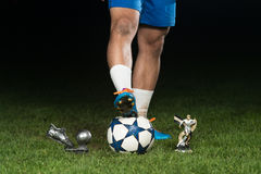 Legs Of Player With Ball And Coup Royalty Free Stock Image