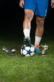 Legs Of Player With Ball And Coup Royalty Free Stock Photo