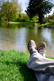 Legs beside a pond. Legs beside a beautiful scenic view of a pond Stock Photos