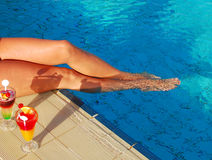Legs in pool Stock Photography