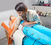 Legs pressotherapy machine on woman in beauty center Stock Photography