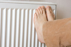 Legs on radiator Stock Photography
