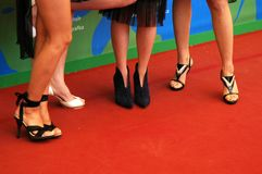 Legs on red carpet. Several woman shoes on red carpet Stock Photography