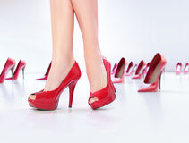 Legs on the red high-heel shoes Royalty Free Stock Photography