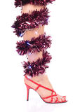 Legs and red high heels. Legs with christmas decorations and red high heel shoes Stock Image