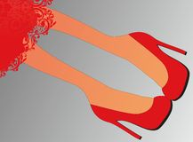 Legs in red high heels Stock Image
