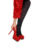 Legs on red shoes. On a white background Stock Photo
