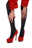 Legs on red shoes Royalty Free Stock Photos