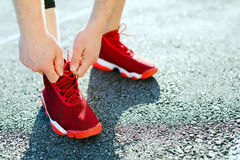 Legs in red sneakers Stock Images