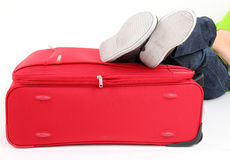 Legs on the red suitcase Stock Photos