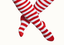 Legs in red and white striped socks Royalty Free Stock Photography
