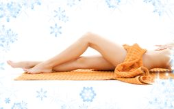 Legs of relaxed lady with orange towel Royalty Free Stock Images