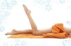 Legs of relaxed lady with orange towel Stock Photo