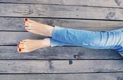 Legs of a relaxing woman Stock Photo