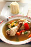 Legs with rice in the bouillon. Tasty legs with rice in the bouillon served in the plate Stock Image