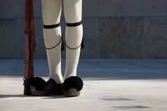Legs and rifle of Greek presidential guardsman Stock Photos