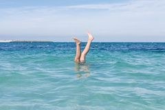 Legs rise above the water Royalty Free Stock Image