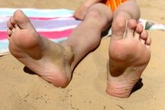 Legs on a river beach Stock Photo