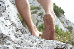 Legs on rocks Royalty Free Stock Photography
