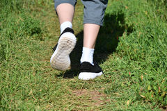 Legs runner boy in sneakers Stock Images