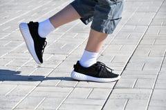 Legs runner boy in sneakers Royalty Free Stock Photo