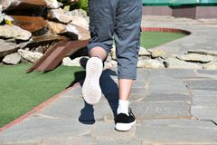 Legs runner boy in sneakers Royalty Free Stock Image