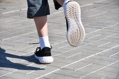Legs runner boy in sneakers Stock Image