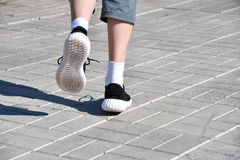 Legs runner boy in sneakers Stock Photo