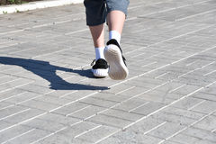 Legs runner boy in sneakers Royalty Free Stock Photography